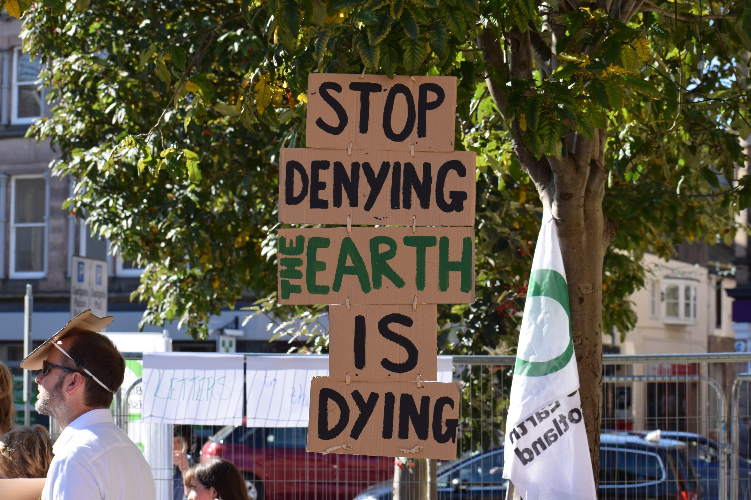 Earth is Dying Sign