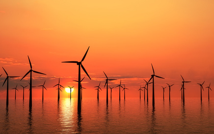 A wind farm at sunset is quite inspiring